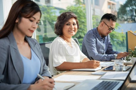 Photo for Asian business people working in office - Royalty Free Image