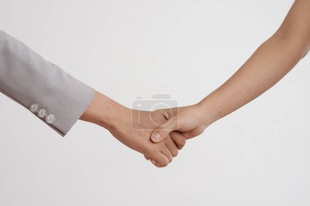 Photo for Female hands shaking hands and isolated on white background, cropped image - Royalty Free Image