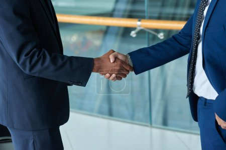 Photo for Cropped image of business people shaking hands - Royalty Free Image