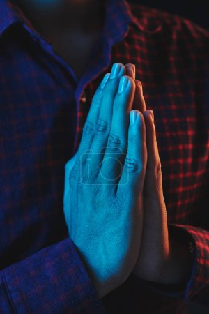 Photo for Man holding hands in namaste gesture to express gratitude - Royalty Free Image