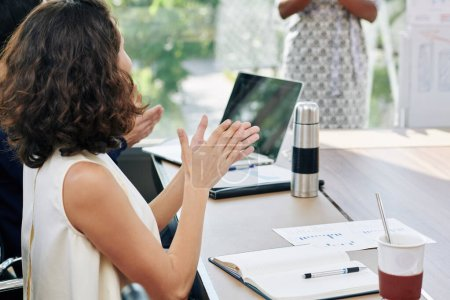 Photo for Female entrepreneur clapping to speaker at business meeting - Royalty Free Image
