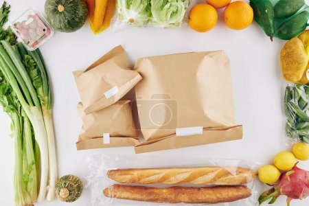 Photo for Paper packages with food delivered to a person staying home during coronavirus pandemic, view from above - Royalty Free Image