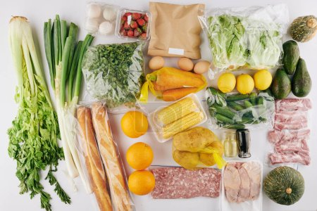 Photo for Set of fresh healthy food with fruits, vegetables and meat prepared for delivery to person social distancing at home - Royalty Free Image