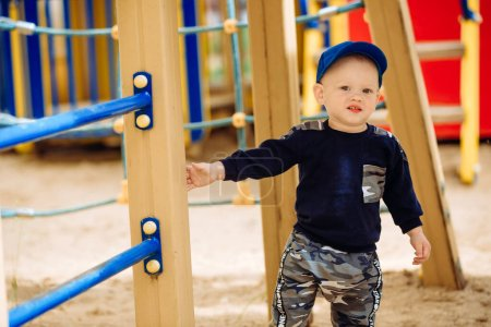 Photo for Funny childish portrait close-up, finger 1-2 years, playground - Royalty Free Image