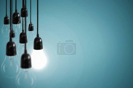 Foto de Concepto de idea con bombilla en el color azul de fondo . - Imagen libre de derechos