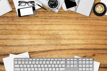 Top view desks with smartphone, keyboard, pencil, coffee mug, glasses, photo paper, Cassette Tapes and other business supplies.