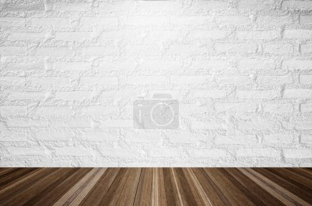 Photo for White brick wall illuminated by the ceiling lamp with copy space. - Royalty Free Image