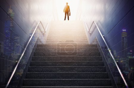 Photo for Rear view of a businessman climbing stairs, Concept into success. - Royalty Free Image