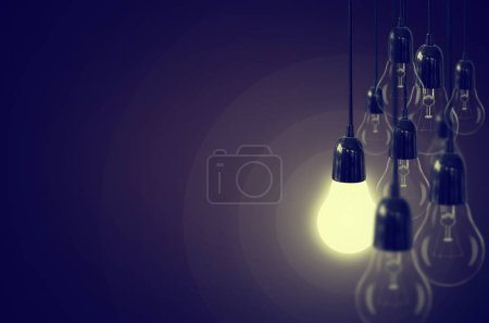 Idea concept with light bulb on the background brown color. Vintage Style.