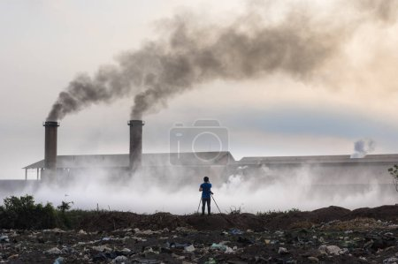 Photo for Air pollution with black smoke from chimneys and industrial waste. - Royalty Free Image