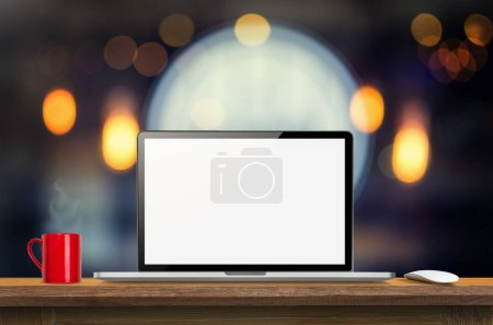 Laptop computer blank screen on wooden table and blurred Coffee shop interior background with bokeh image, for product display montage,can be used for montage or display your products