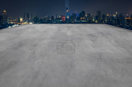 Empty rooftop of building with modern cityscape background