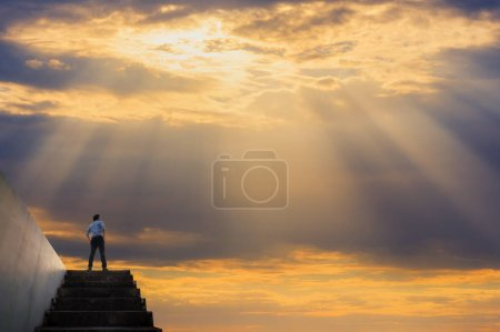 businessman on top of the stairs to the sky, Success business concept.