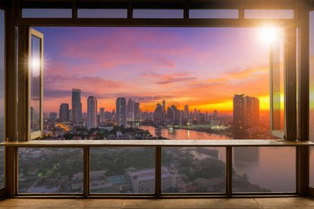 Beautiful Blank coffee shop or (cafe,restaurant) against blurred bangkok city view background, For montage product display or design key visual layout,  at sunrise.