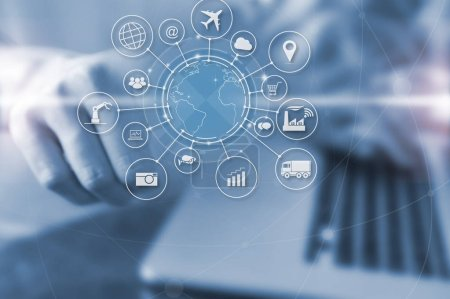 Businessman pressing on virtual screen Internet of things (IOT) word and objects icon connecting together, Internet networking concept, Connect global wireless devices with each other.