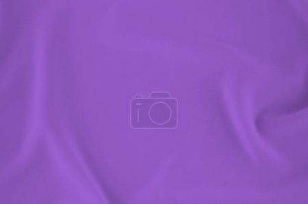 Smooth elegant Ultra violet silk or satin luxury cloth can use as wedding background. Luxurious Christmas background or New Year background design. purple fabric texture. Cloth Textile Surface.