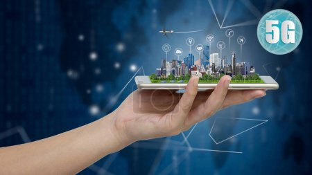 Photo for 5G network wireless systems and internet of things, Smart city and communication network with Modern city model on smartphone in hand,  Connect global wireless devices. - Royalty Free Image