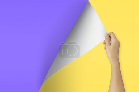 Change concept, Woman hand turning blank yellow paper page to violet paper.