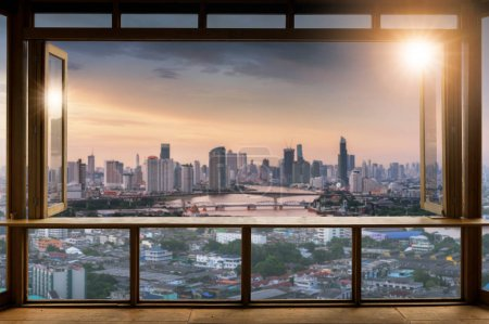 Photo for Beautiful Blank coffee shop or (cafe,restaurant) against blurred bangkok city view background, For montage product display or design key visual layout,  at sunrise. - Royalty Free Image