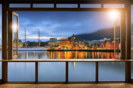 Photo for Beautiful Blank coffee shop or (cafe,restaurant) against blurred Famous Bryggen street with wooden colored houses in Bergen, Norway background, For montage product display or design key visual layout. - Royalty Free Image