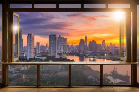 Photo for Beautiful Blank coffee shop or cafe,restaurant against blurred bangkok city view background, For montage product display or design key visual layout,  at sunrise. - Royalty Free Image
