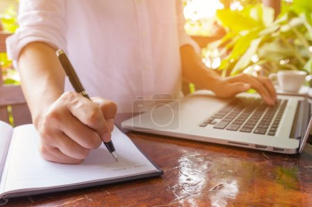Freelance female hands on the keyboard of laptop in a cafe, girl using laptop typing, web searching
