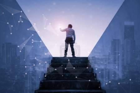 Photo for Businessman climbed on top of stairs going to city,  Ambitions concept and Success business with abstract network technology. - Royalty Free Image