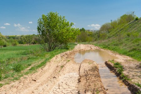Spring landscape with clay dirty road in Ukraine