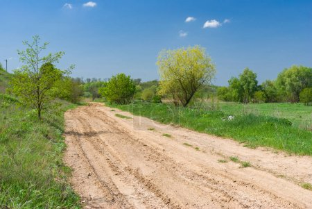 Spring landscape with clay road in Ukraine
