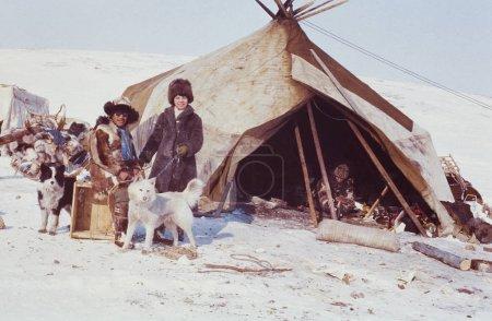 Chukchi Peninsula, USSR - May 1983: Caucasian woman visiting remote station of the indigenous people