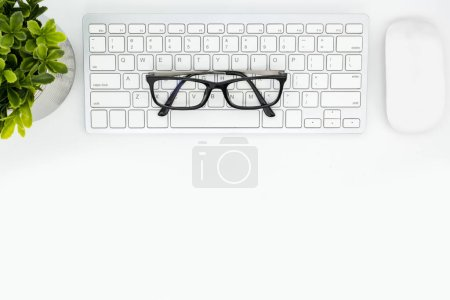 Photo for White hipster desk table with computer keyboard and mouse. Top view with copy space, flat lay. - Royalty Free Image