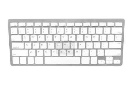 White wireless computer keyboard isolated on white background.
