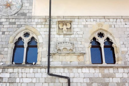 Detail of the facade of the historic town hall in Venzone, Italy