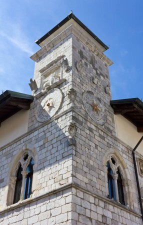 Corner tower of the historic town hall in Venzone, Italy