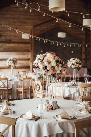 Photo for Decorated with flowers and served for wedding banquet tables indoors - Royalty Free Image