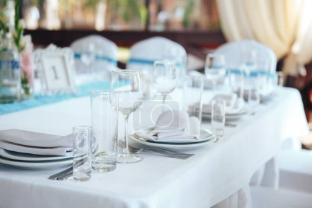 Photo for Glassware and cutlery for catered event dinner. Festive table setting in the restaurant. - Royalty Free Image