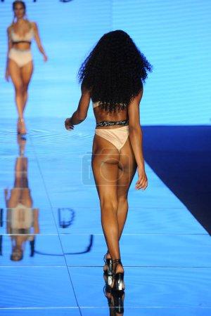 MIAMI BEACH, FL - JULY 12: A model walks the runway for Monica Hansen during the Paraiso Fashion Fair at The Paraiso Tent on July 12, 2018 in Miami Beach, Florida.