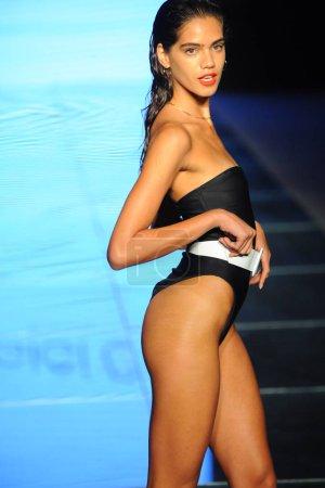 MIAMI BEACH, FL - JULY 14: A model walks the runway for Gigi C Bikinis during the Paraiso Fashion Fair at The Paraiso Tent on July 14, 2018 in Miami Beach, Florida.