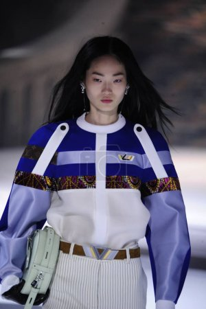 PARIS, FRANCE - MARCH 06: A model walks the runway during the Louis Vuitton show as part of the Paris Fashion Week Womenswear Fall/Winter 2018/2019 on March 6, 2018 in Paris, France.