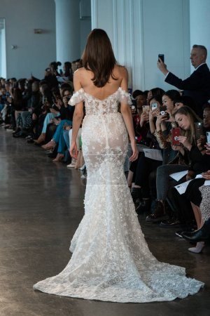 Photo for NEW YORK, NY - APRIL 12: A model walks the runway  during the Berta Bridal Spring 2020 fashion collection at New York Fashion Week: Bridal on April 12, 2019 in NYC. - Royalty Free Image