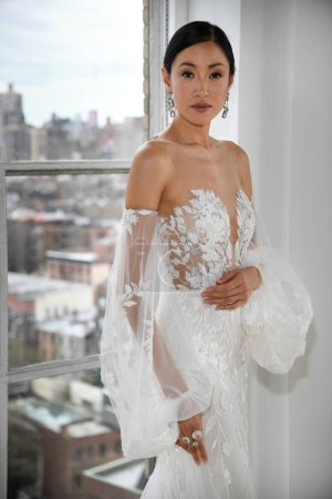 Photo for NEW YORK, NY - APRIL 15: A model posing during the Ines Di Santo Spring 2020 bridal fashion presentation at New York Fashion Week: Bridal on April 15, 2019 in NYC. - Royalty Free Image
