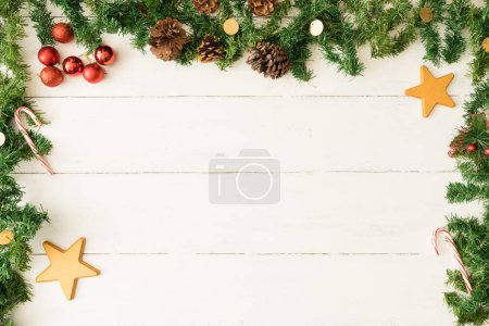 Photo for Christmas background with garland frame and stars, pine cones and ornaments. Plenty of copy space - Royalty Free Image