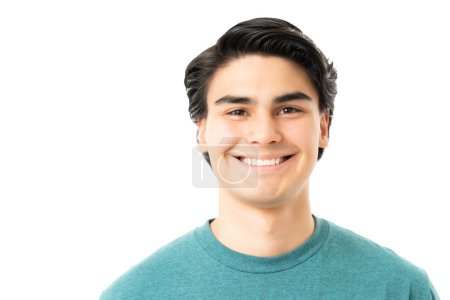 Photo for Happy handsome Hispanic young man isolated over white background - Royalty Free Image