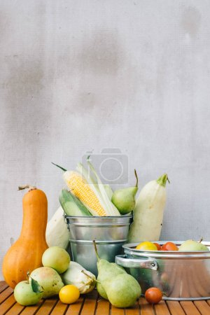 Photo for Buckets with ripe fruits and vegetables on wooden table, squash, pumpkins, pears - Royalty Free Image