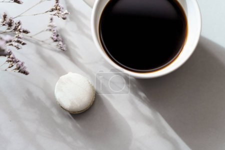 Photo for Cup of coffee and macaron on gray background - Royalty Free Image