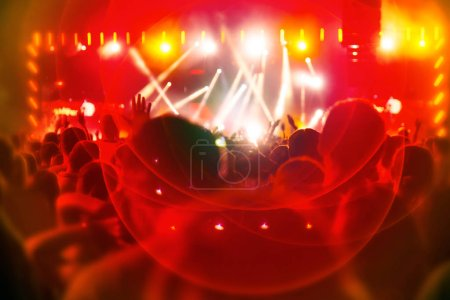 Photo for Silhouettes of fans and musicians at stage, bright spotlights at music concert - Royalty Free Image