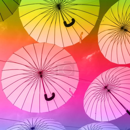 background of colorful umbrellas against sky, street decoration