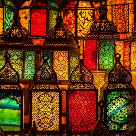 muslim style lanterns shining in dark room