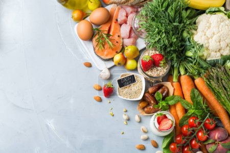 Photo for Balanced nutrition concept for DASH clean eating flexitarian mediterranean diet to stop hypertension and low blood pressure. Assortment of healthy food ingredients for cooking on a kitchen table. - Royalty Free Image