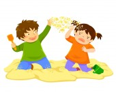 Naughty boy throwing sand at a little girl in the sandbox